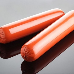 Orange casings for cooked round sausages